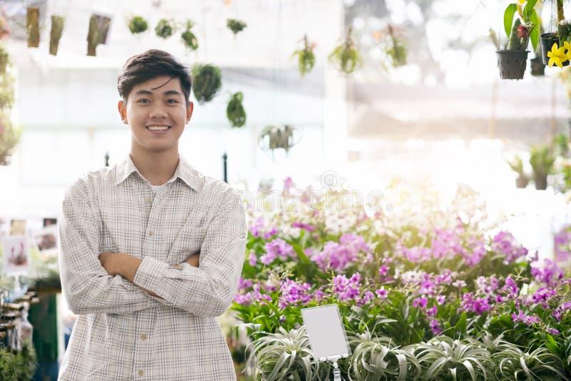 Deposito sicuro del negozio di fiore delle orchidee di piccola impresa del proprietario immagine stock libera da diritti