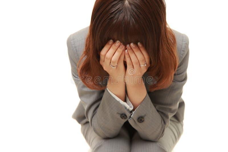 Depressed businesswoman foto de archivo