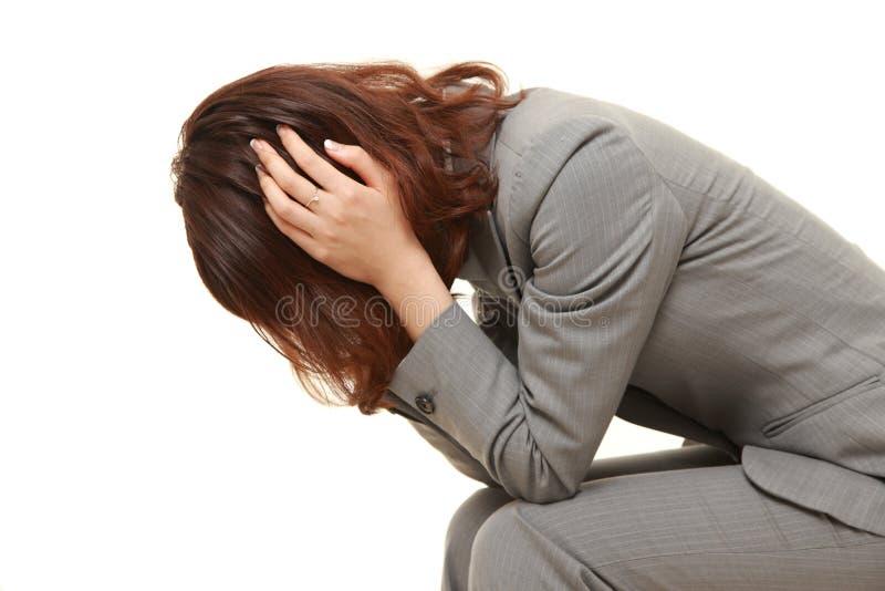 Depressed businesswoman fotos de archivo