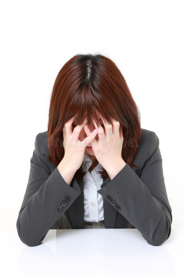 Depressed businesswoman foto de archivo libre de regalías