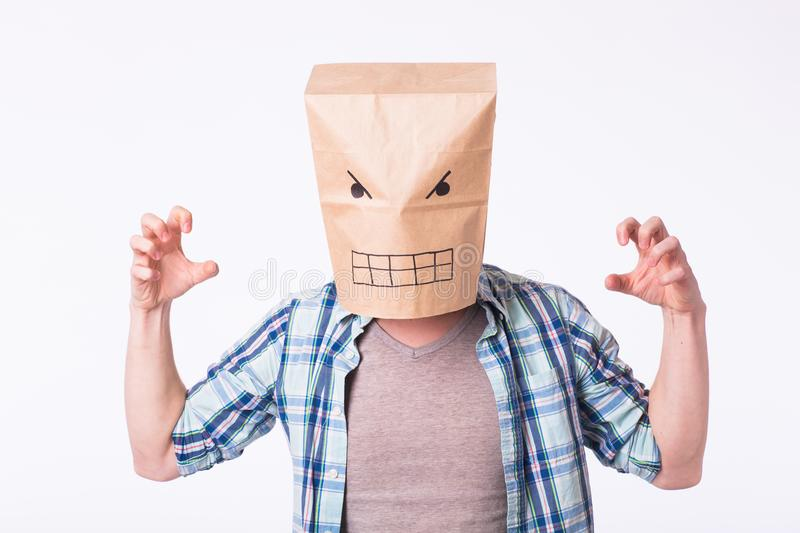 Depressed angry man with picture emotional face on box over head.  royalty free stock photo