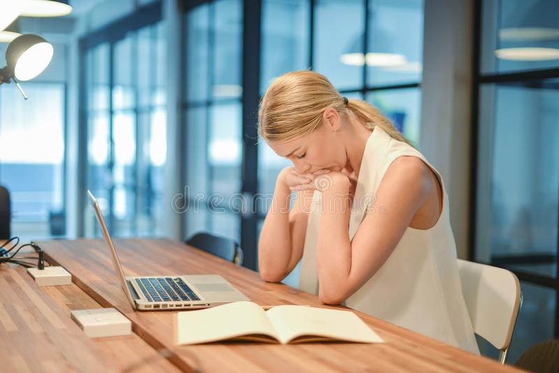 Depressed business blonde woman having troubles with her works stock photography