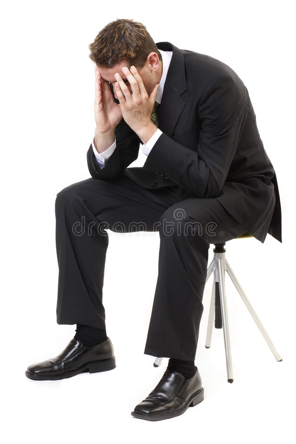 Depressed businessman. Sitting face in hands stock photography