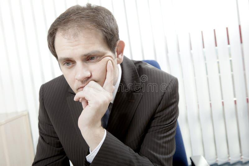 Depressed businessman thinking stock image