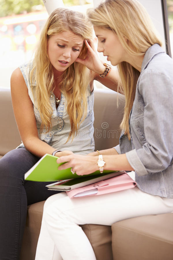 Depressed College Student Talking To Counselor royalty free stock photography
