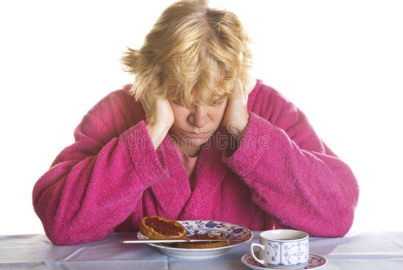 Depressed elderly woman stock photo