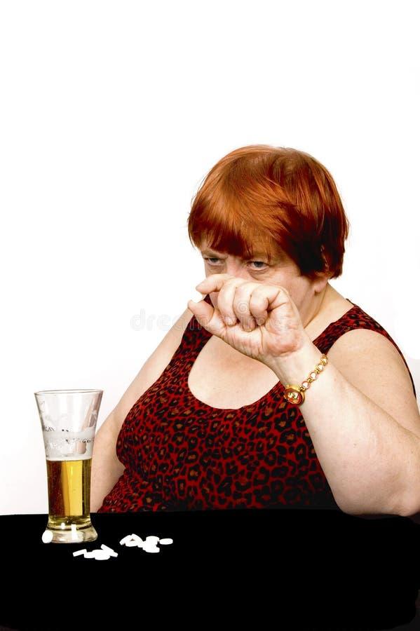 Depressed elderly woman royalty free stock photo