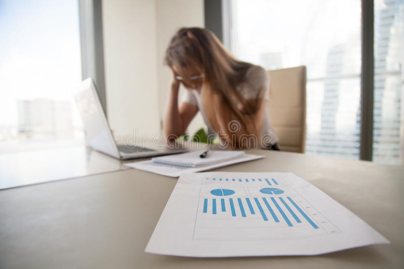 Depressed frustrated businesswoman shocked by company bankruptcy. Depressed frustrated businesswoman holding head in hands, female boss shocked by decreasing royalty free stock photo