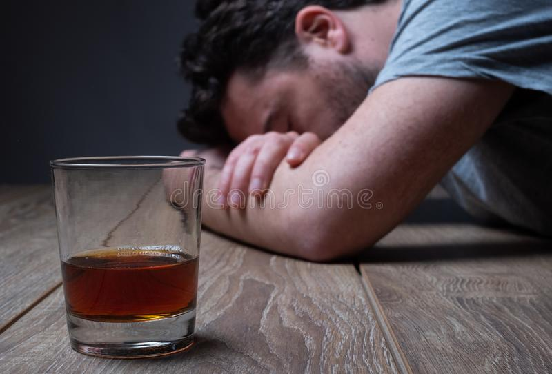 Depressed man drinking hard liquor at home stock images