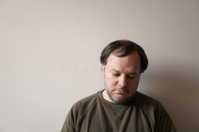 Depressed man in his forties royalty free stock photo