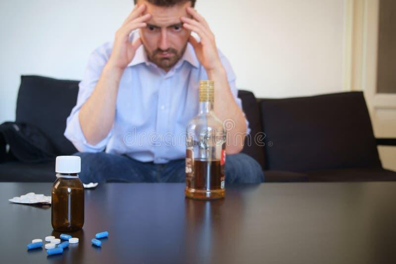 Depressed man taking pills stock photos