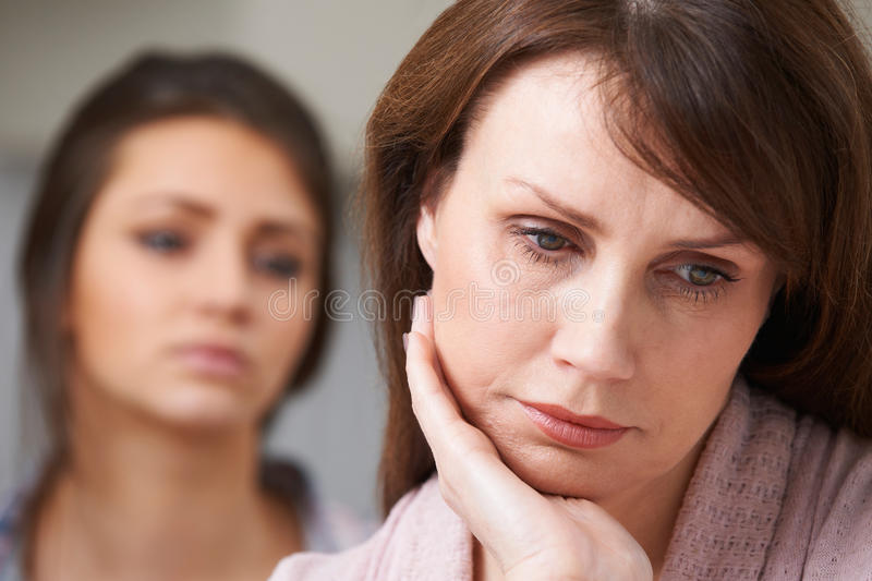 Depressed Mother With Teenage Daughter stock photos