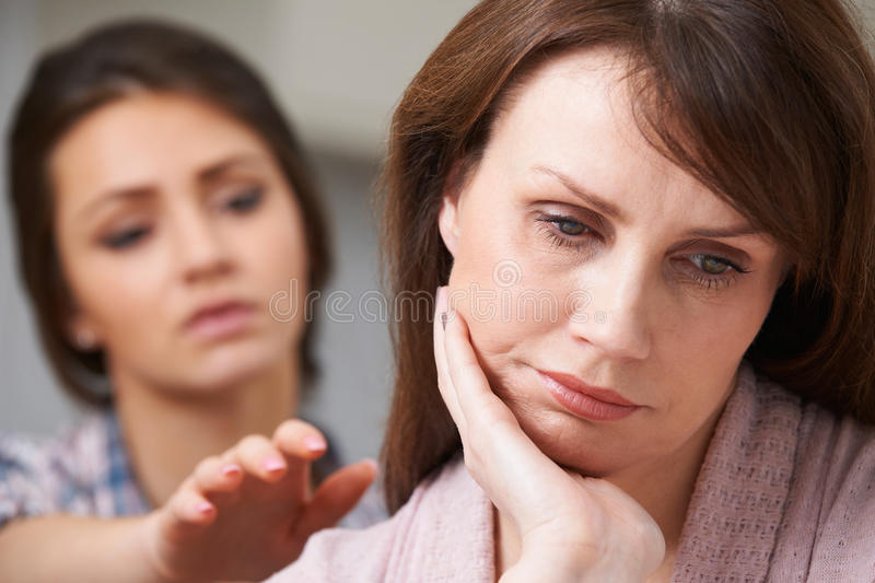 Depressed Mother With Teenage Daughter. Depressed Mother And Teenage Daughter stock photography