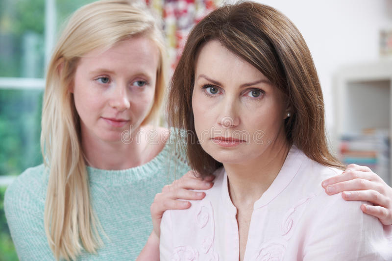 Depressed Mother With Teenage Daughter. Portrait Of Depressed Mother With Teenage Daughter royalty free stock photos