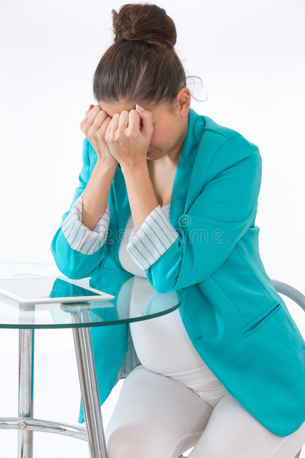 Depressed pregnant woman talking with nobody to support stock photos