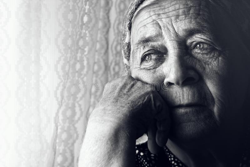 Depressed sad old woman royalty free stock photos