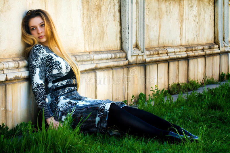 Download Depressed Sad Woman Near Grungy Wall Stock Photo - Image: 9389622