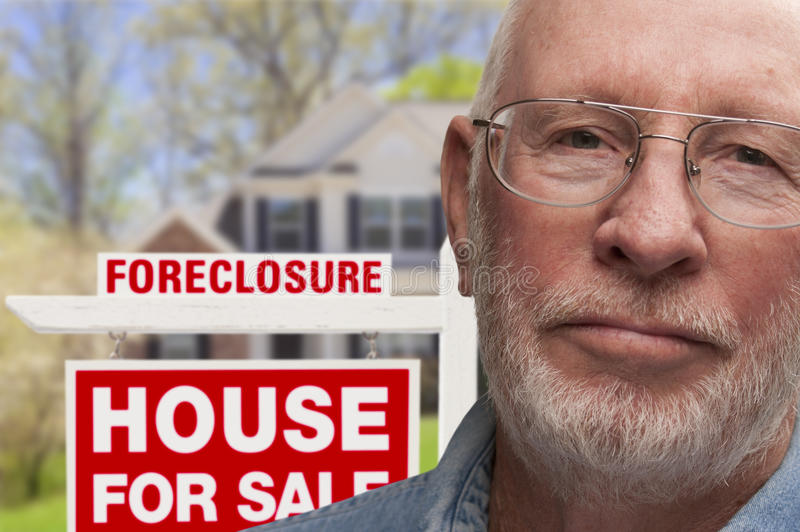Download Depressed Senior Man In Front Of Foreclosure Sign And House Stock Image - Image: 32130017