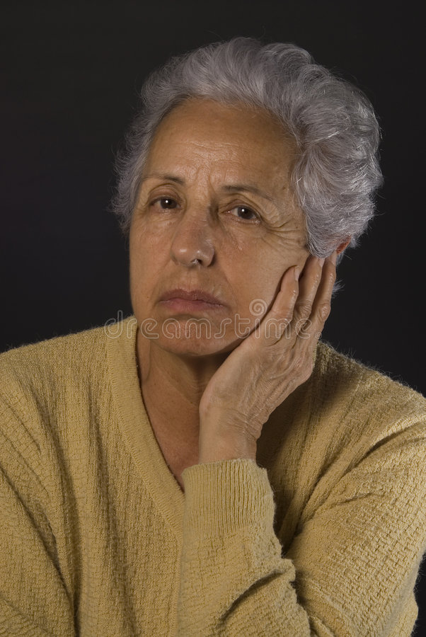 Depressed senior woman stock images