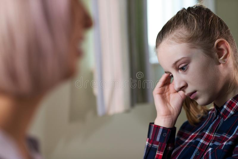 Depressed Teenage Girl Meeting With Counselor royalty free stock image