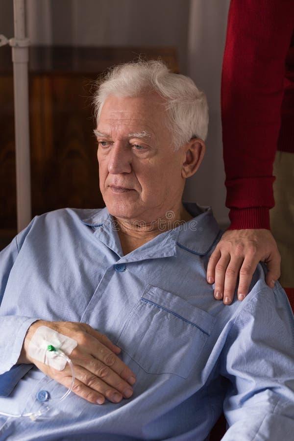Depressed terminally ill senior. Image of depressed terminally ill senior having care royalty free stock images