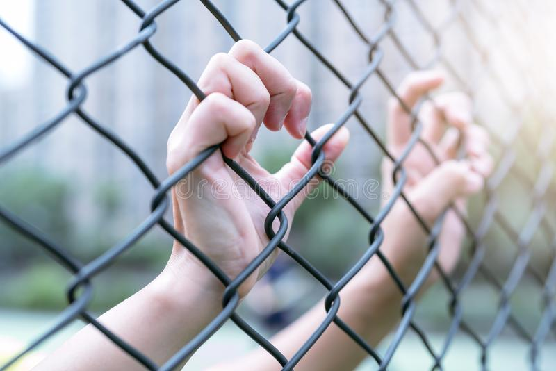 Depressed, trouble and solution. Women hand on chain-link fence. royalty free stock photography