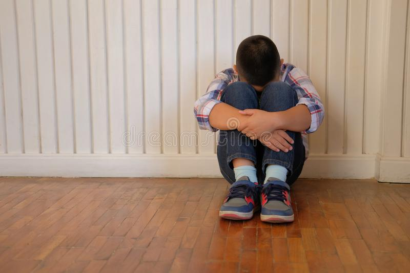 depressed upset sad asian kid boy child children sitting on floor stock photos