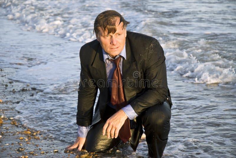 Depressed wet businessman stock photos