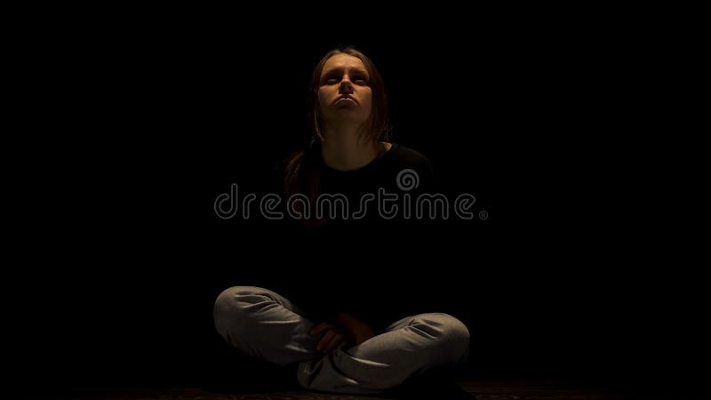 Depressed woman praying for end of suffering, victim of domestic violence. Stock photo royalty free stock image
