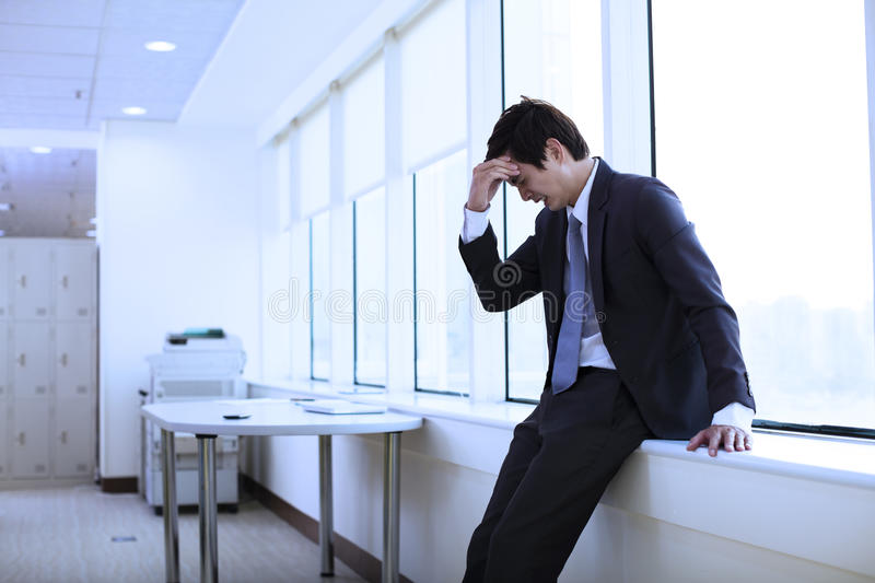 Depressed young business man royalty free stock photo