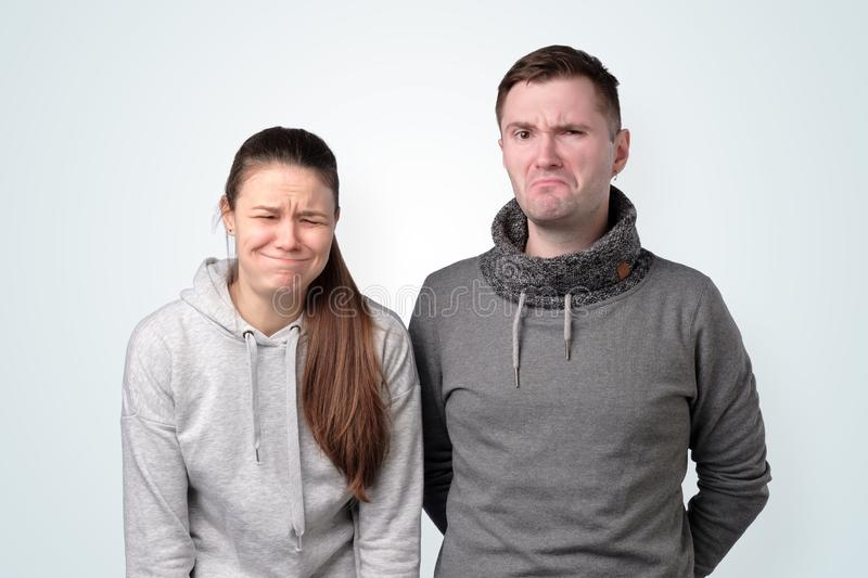 Depressed young couple having relationship troubles. Studio shot royalty free stock photography