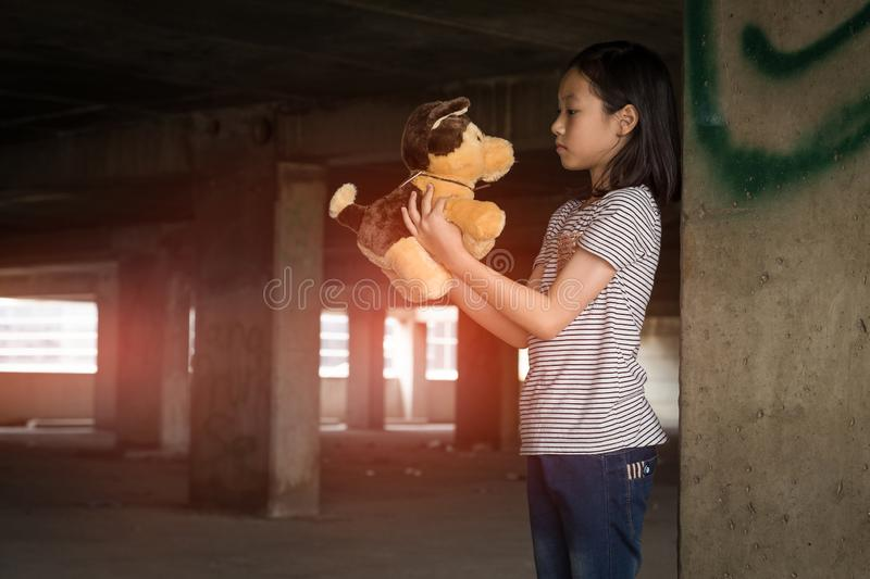 Depressed young girl standing alone in an abandoned building,Neglected,Children with Behavioral and Emotional Disorders stock photos