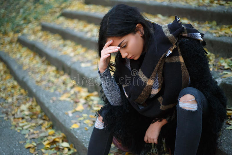 Depressed young woman outdoors royalty free stock photo