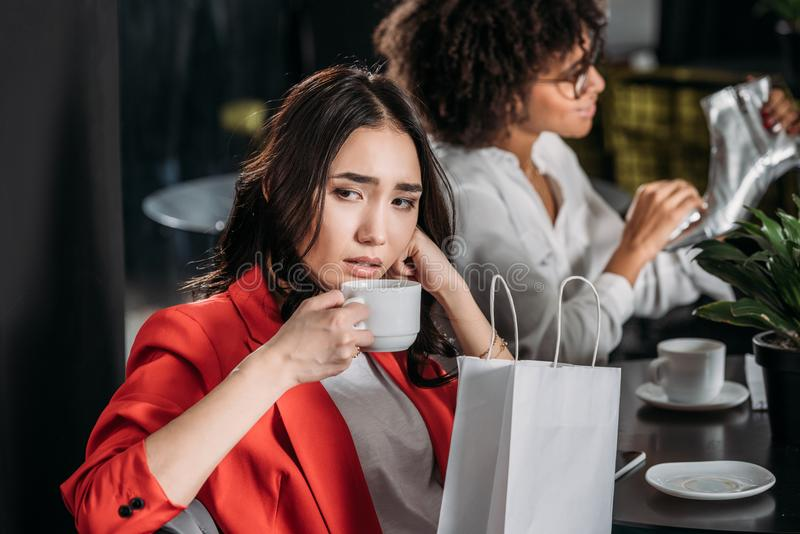 depressed young woman drinking coffee royalty free stock photography