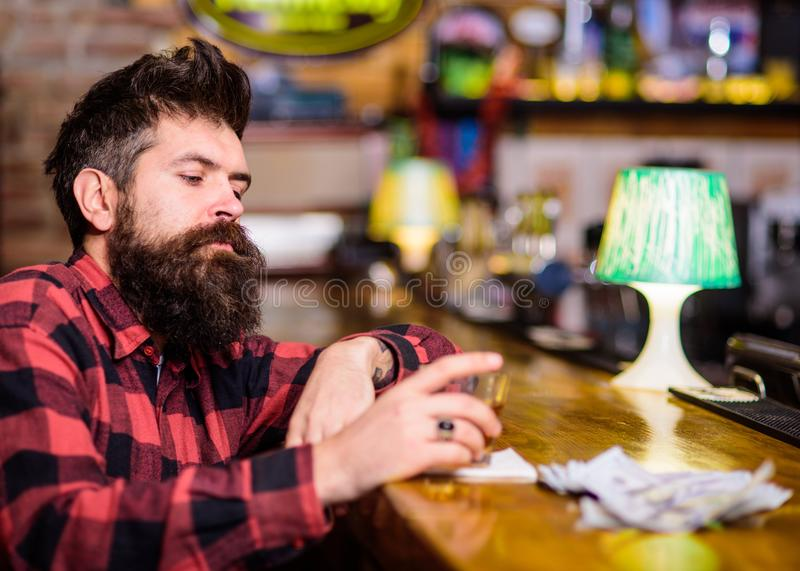 Depression and alcoholism concept. Man with sad face sit alone stock images