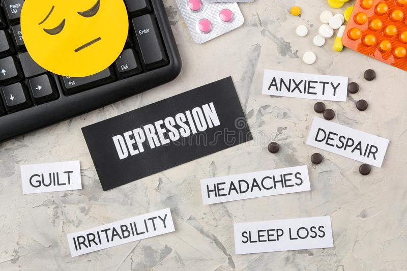 Depression concept. Psychological illness. the word depression on paper and symptoms of depression and pills on a light background. Top view stock photos