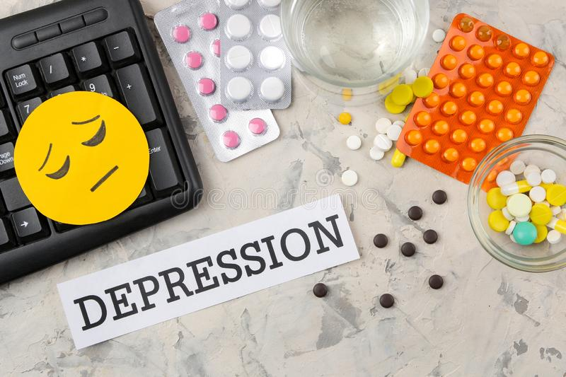 Depression concept. Psychological illness. the word depression on paper and pills on a light background. top view royalty free stock photo