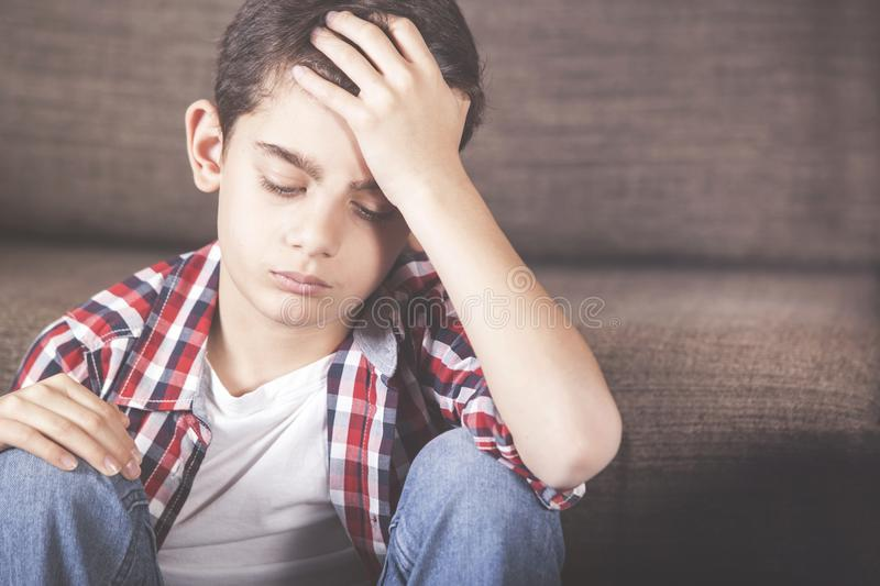 Depression concept with sad kid stock image