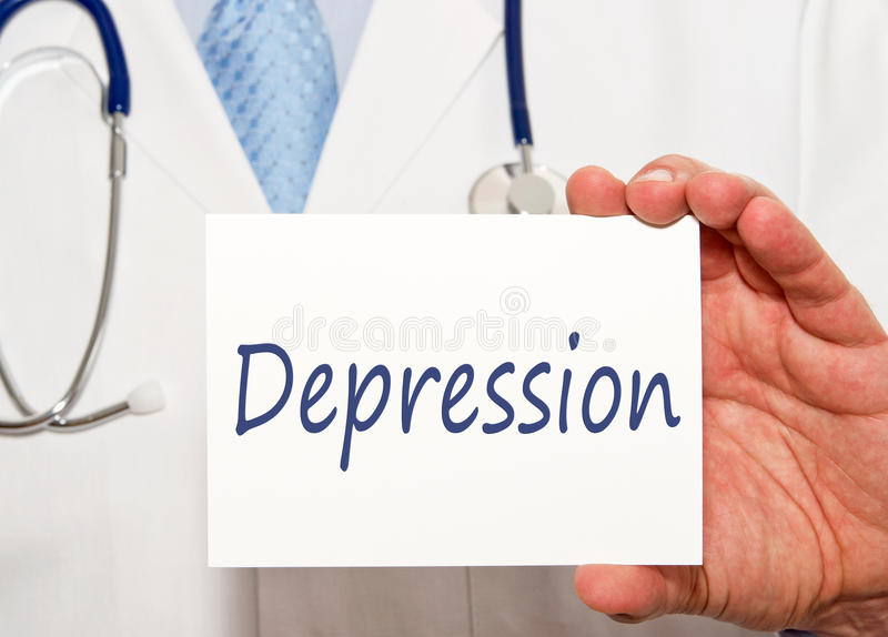Depression - Doctor holding sign with text. In his hand royalty free stock image