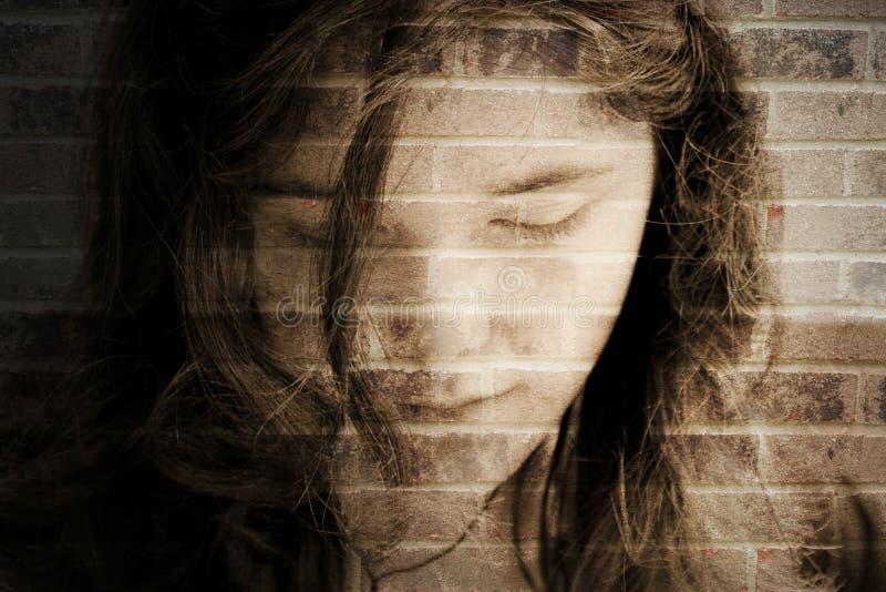 Depression hurts. Sad girl depressed abstract in brick wall