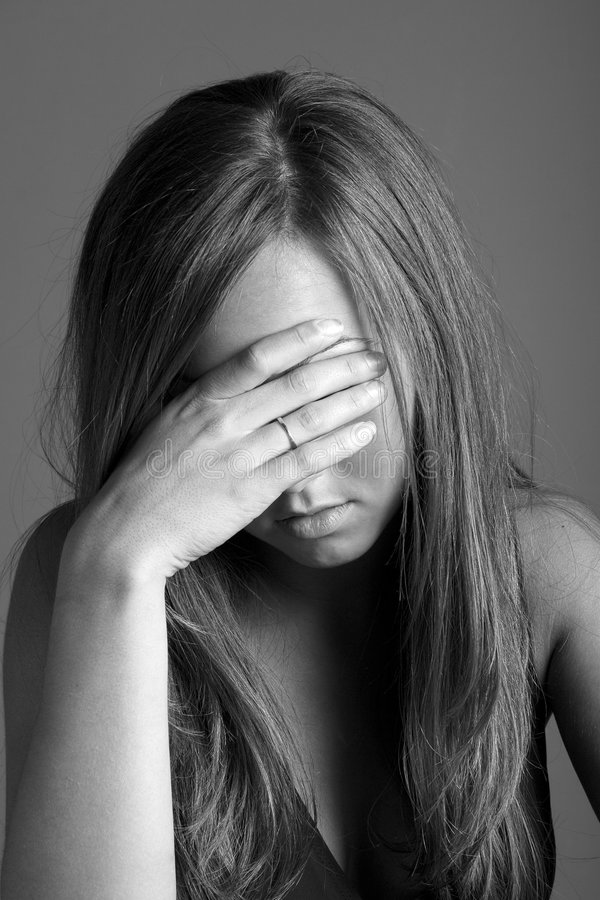 Depression and sorrow. Young woman in depressed state royalty free stock photography