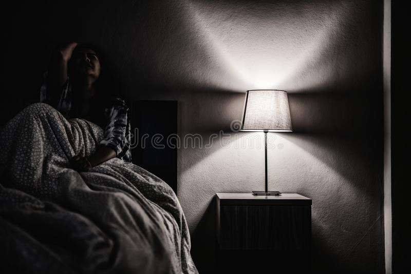 Depression woman alone in the dark room. Mental health problem, PTSD. Is Post-traumatic stress disorder stock image