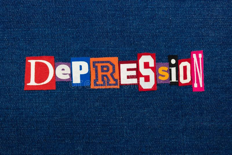 DEPRESSION word text collage, multi colored fabric on blue denim, mental health concept. Horizontal aspect royalty free stock photography