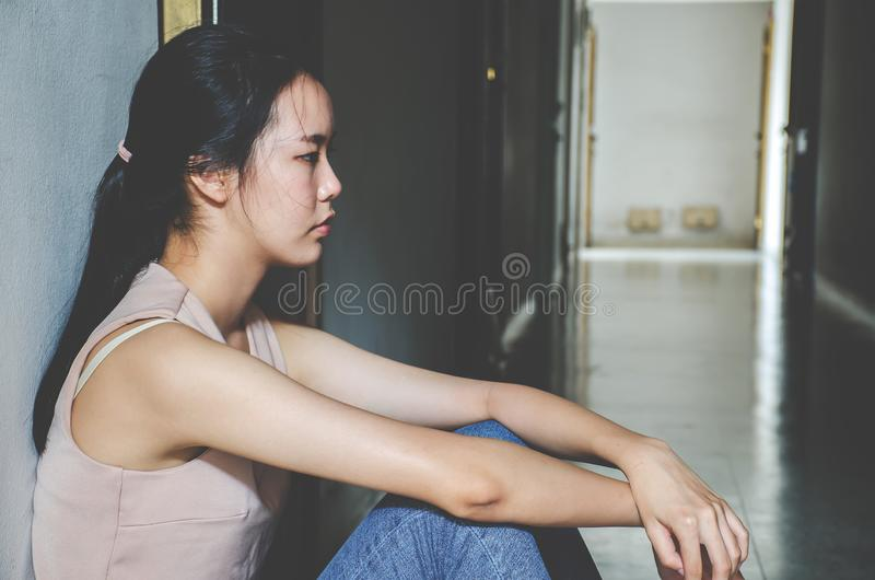Depression young girl teenager having abused problem feeling suffering sitting alone in the dark room, Domestic violence,. Family problems, Stress, violence stock images