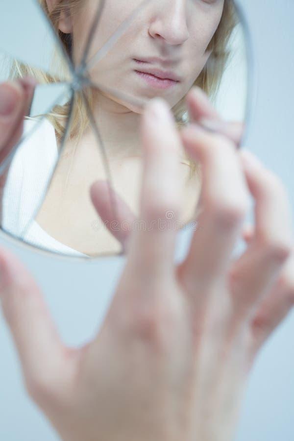 Deprimerad kvinna med schizofreni fotografering för bildbyråer