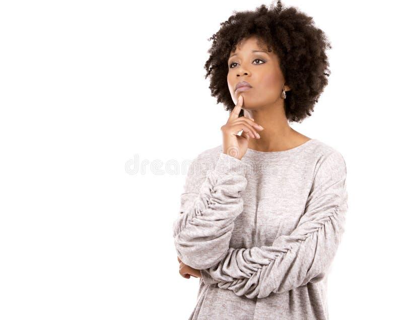 Deprimerad svart tillfällig kvinna på vit bakgrund royaltyfria foton
