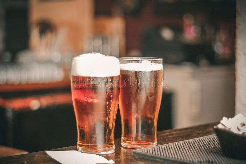 Depth of Field Photo of Two Pilsner Glasses royalty free stock photos