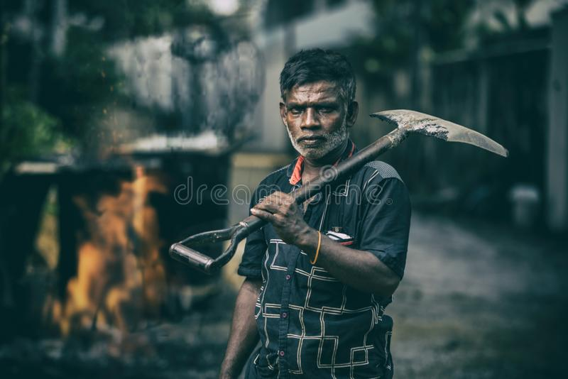 Depth of Field Photography of Man in Black Shirt Holding Shovel stock image