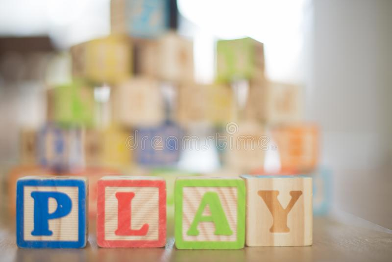 Depth of Field Photography of P, L, A, Y Wooden Letter Decors on Top of Beige Wooden Surface stock image