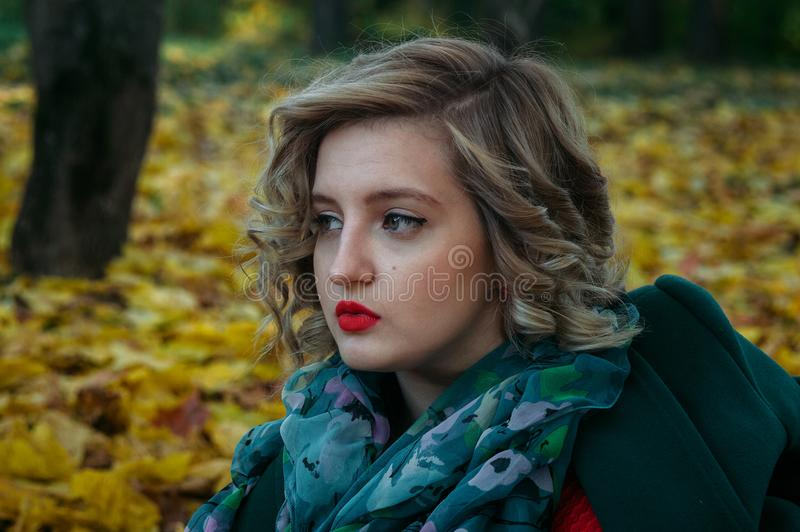 Depth of Field Photography of Woman With Green and White Floral Chiffon Fabric Scarf royalty free stock photo